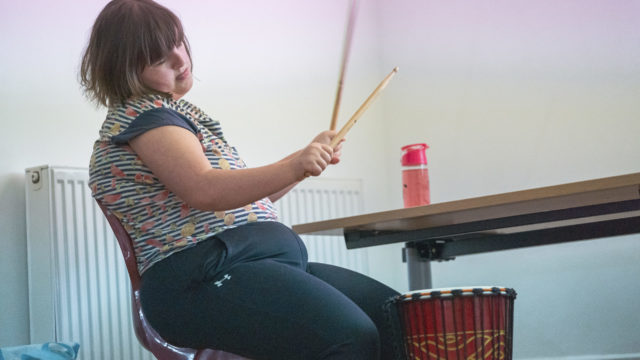 Student playing the drums