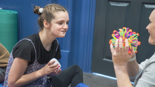 Student staring at a sensory toy