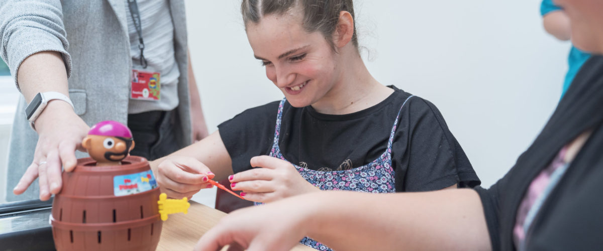 Student smiling playing a game