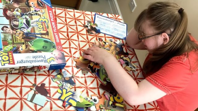 Day Service member completing a jigsaw
