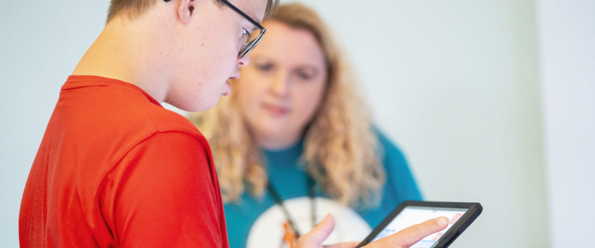 Student using ipad software to communicate with tutor