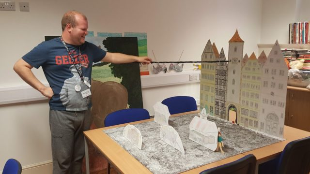 Day Service member playing with social history model