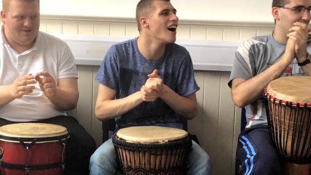Day Service members using african drums