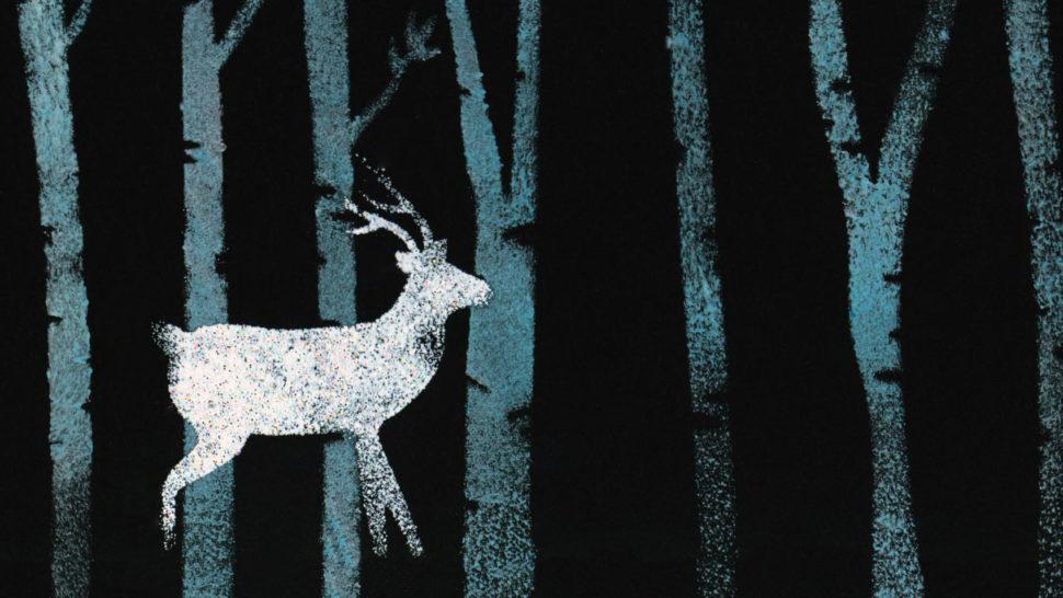 Metal-printed deer in a wood
