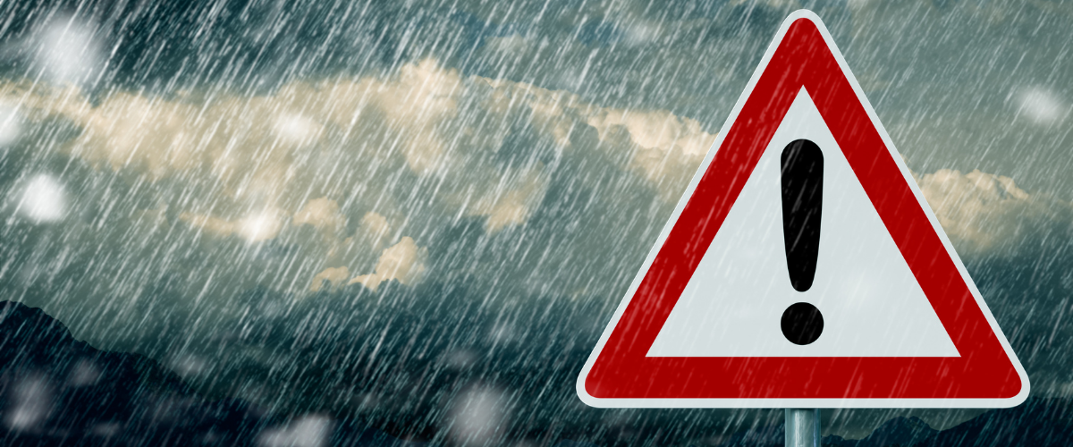 Warning sign with stormy weather